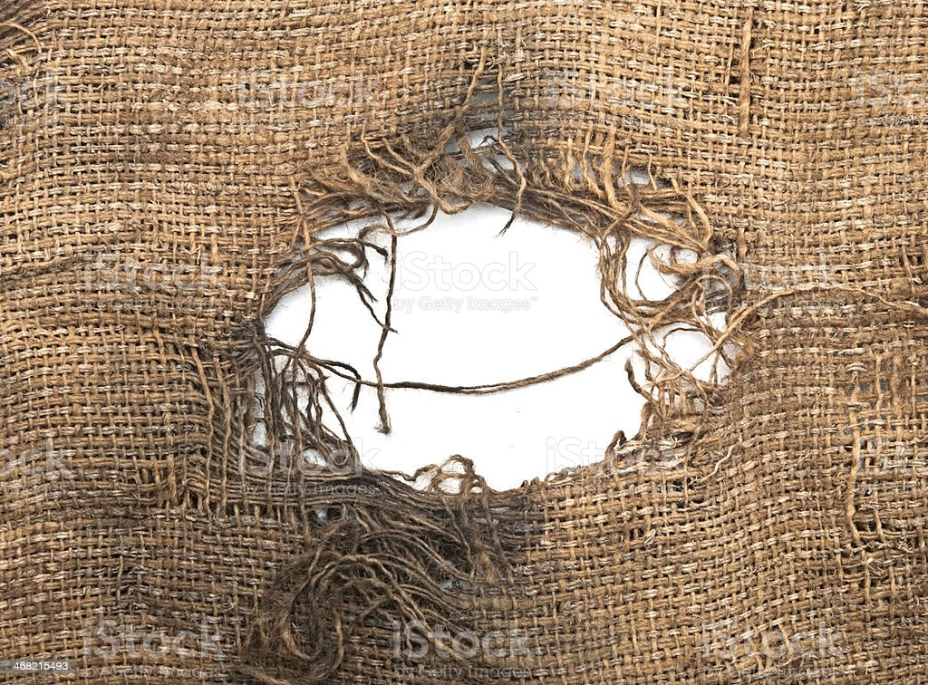 Torn burlap decayed. Ragged linen fabric. stock photo