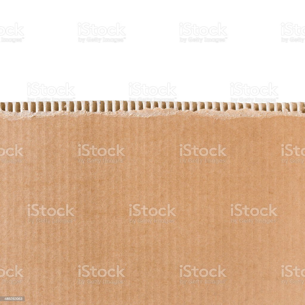 Torn cardboard sheet with place for text. stock photo