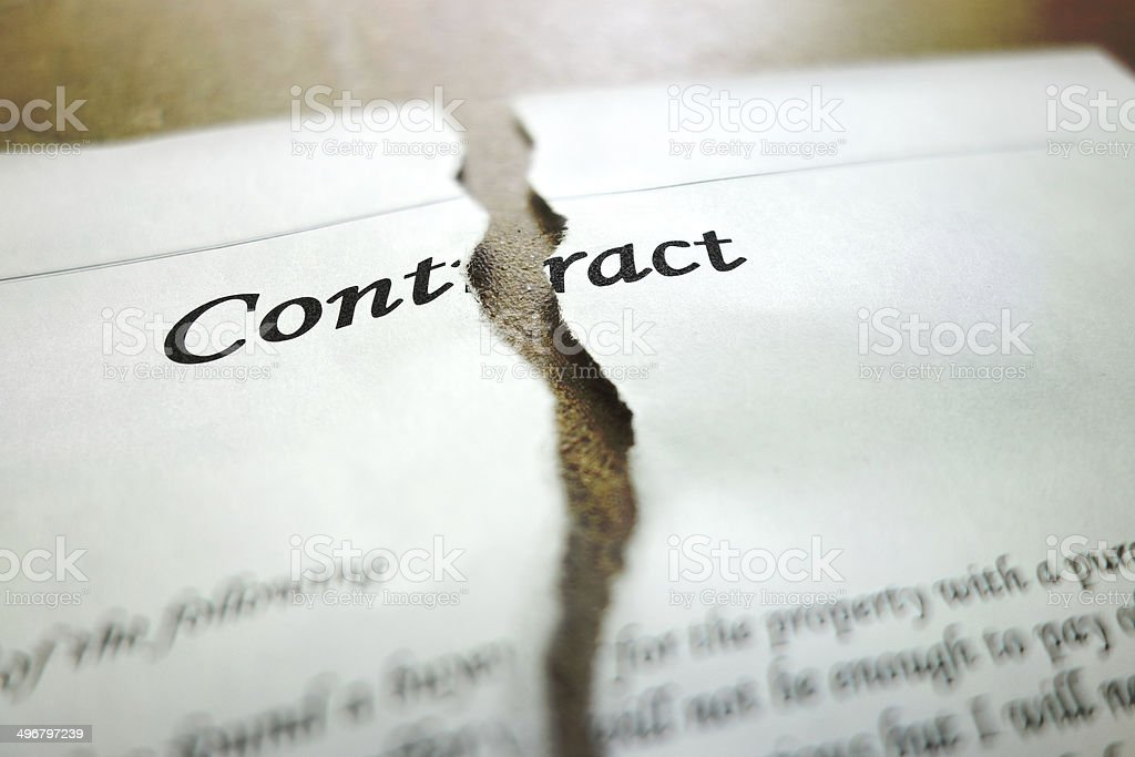 torn contract stock photo