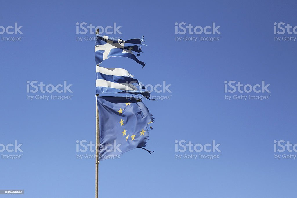 Torn Greek and European Union flag stock photo