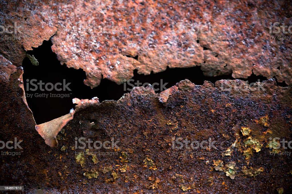 Torn hole in rusty metal plate royalty-free stock photo