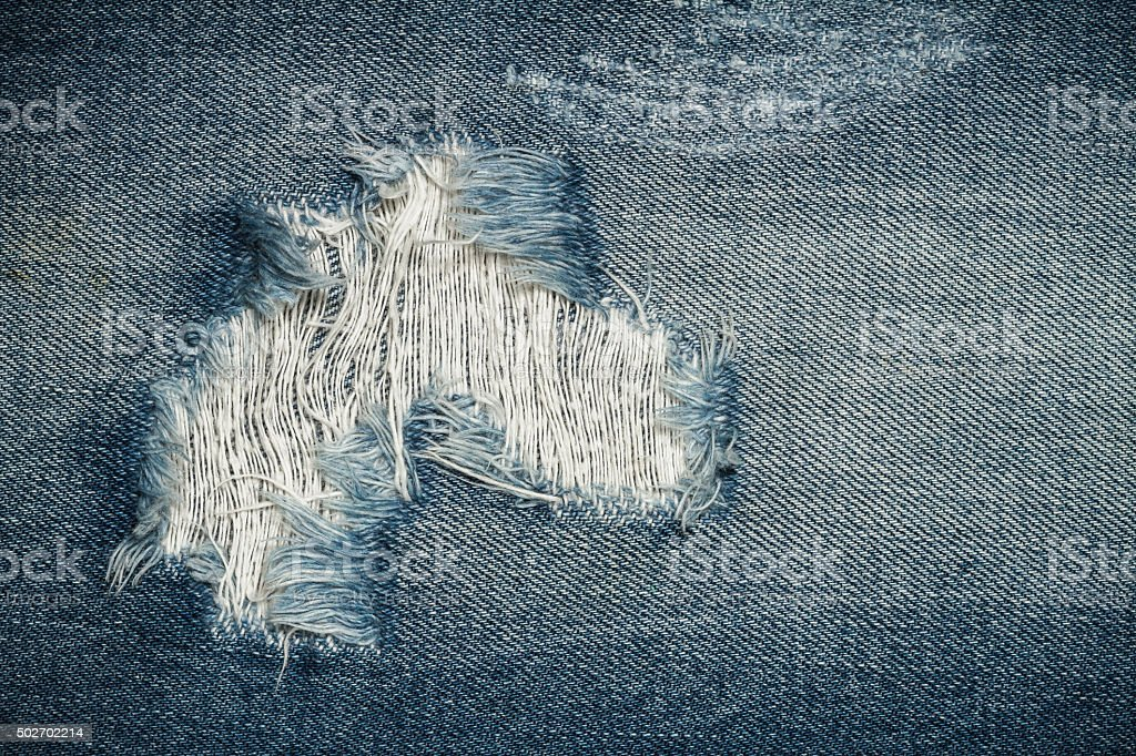 Torn Jeans texture stock photo