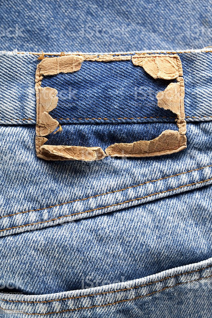 Torn label on blue jeans royalty-free stock photo