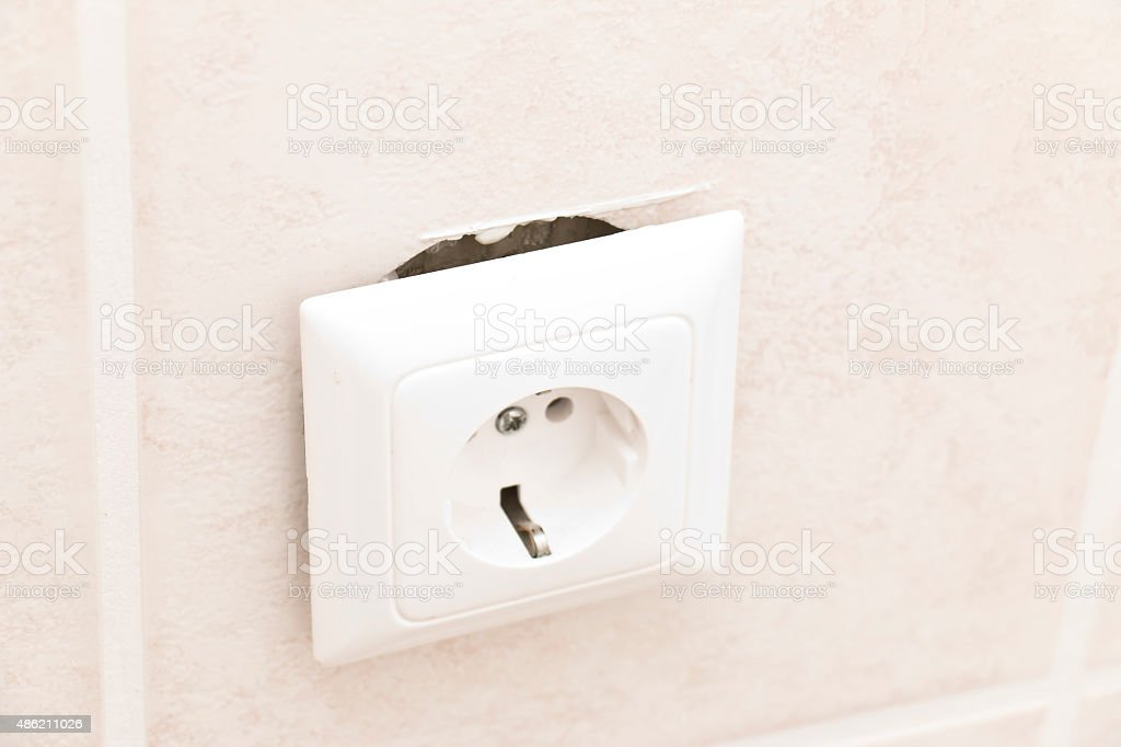 Torn out European 220 volt outlet stock photo