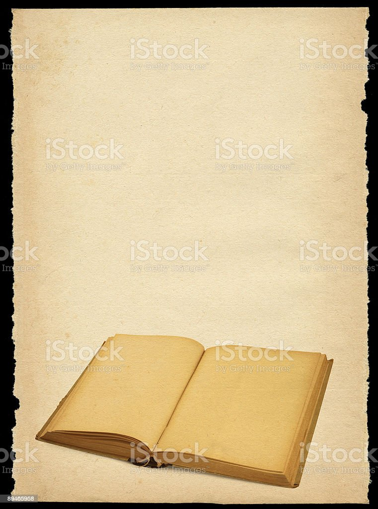 torn out old sheet of paper with open book royalty-free stock photo