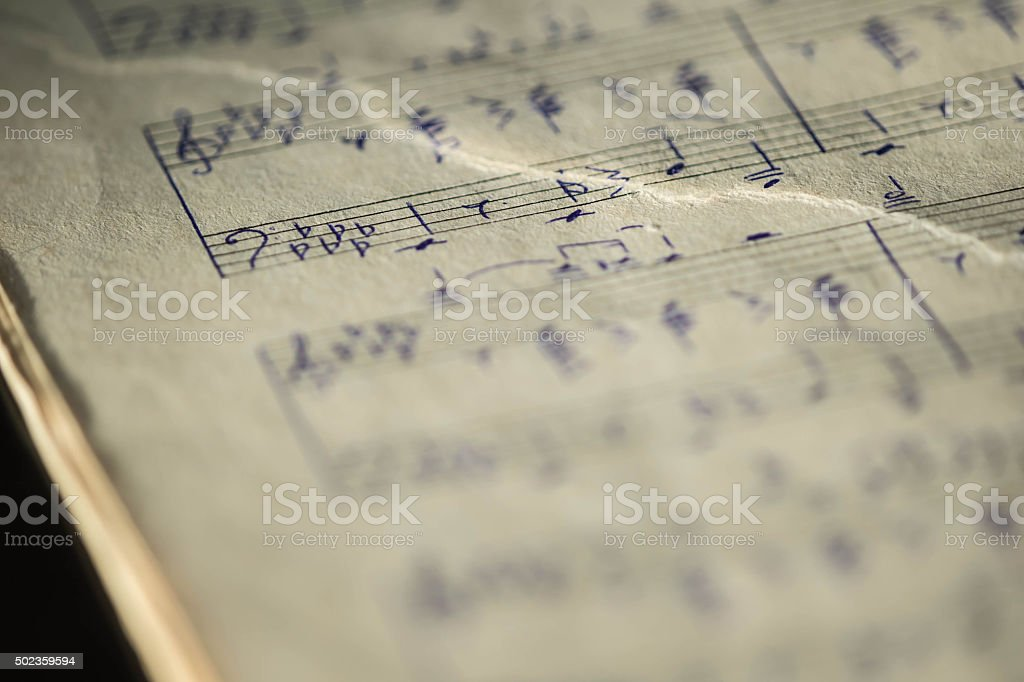 Torn page notebook with handwritten notes for piano stock photo