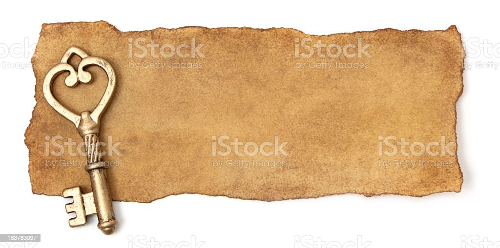Torn paper and antique key stock photo