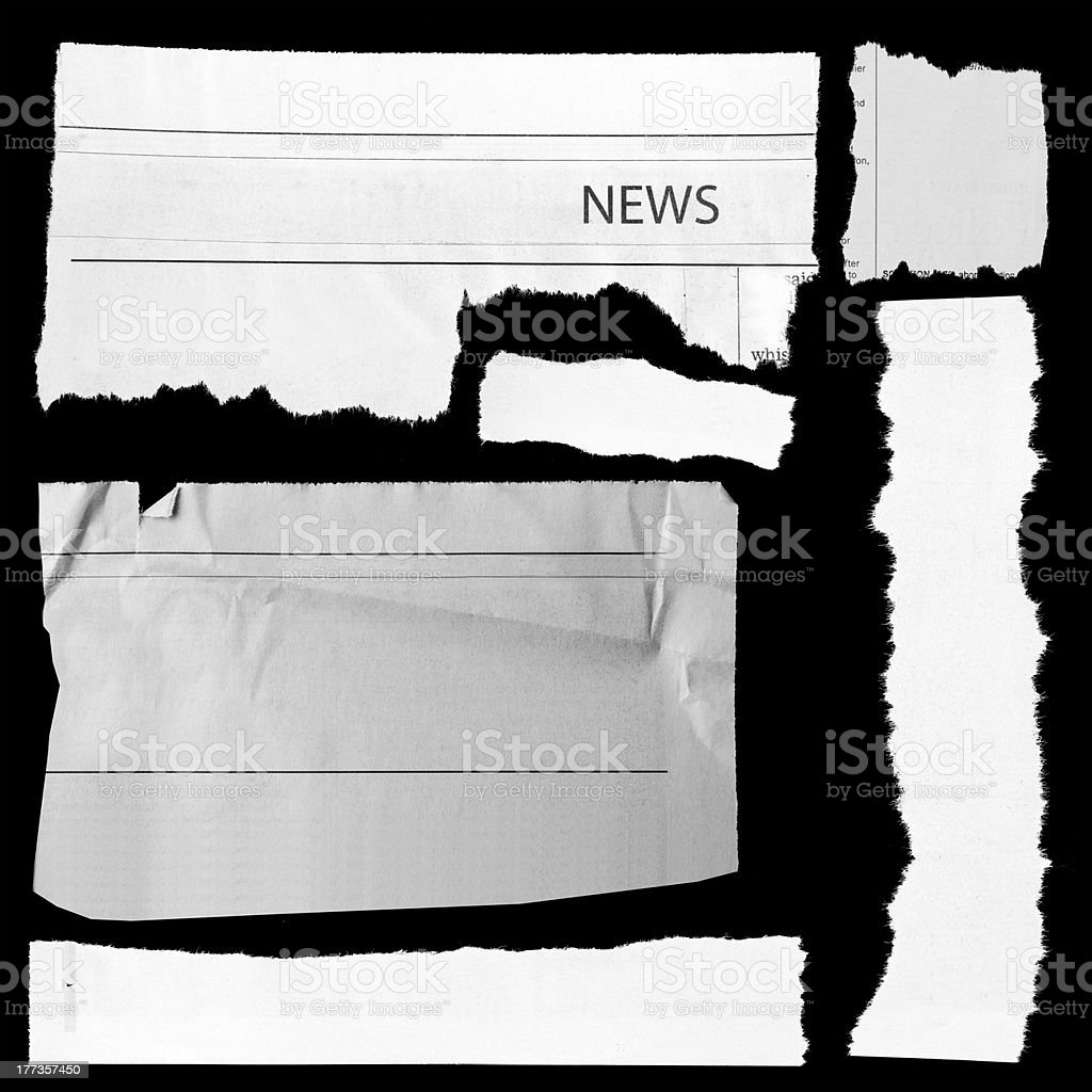 Torn paper on black stock photo