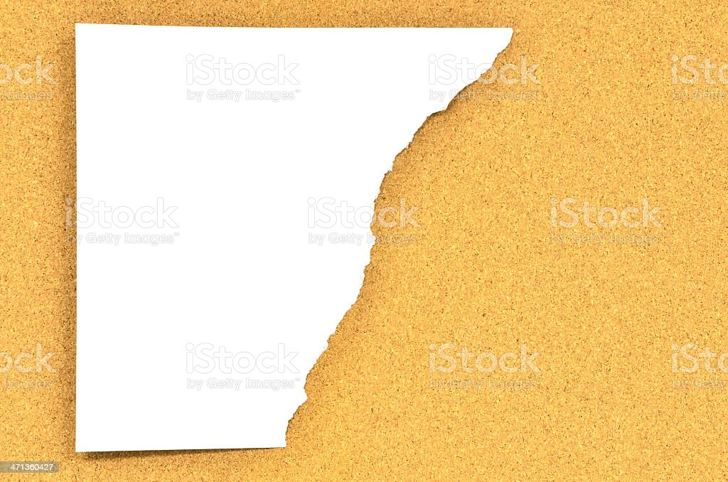 Torn paper on corkboard royalty-free stock photo