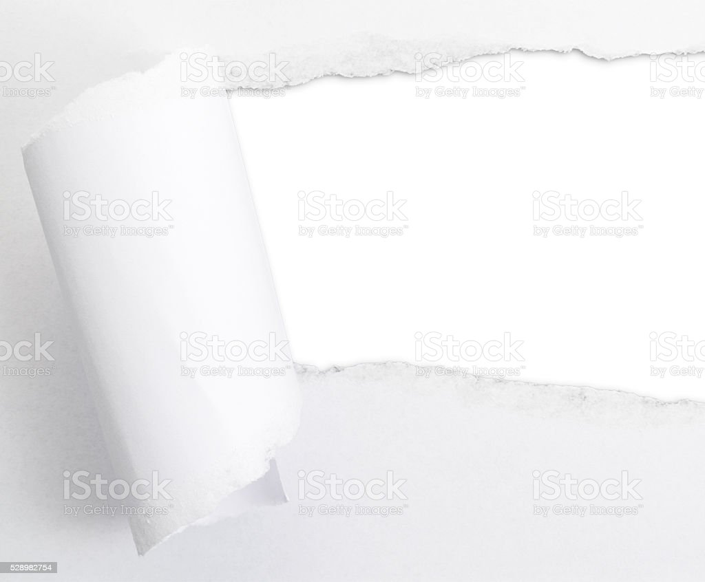 Torn paper sheet with an empty gap hole stock photo