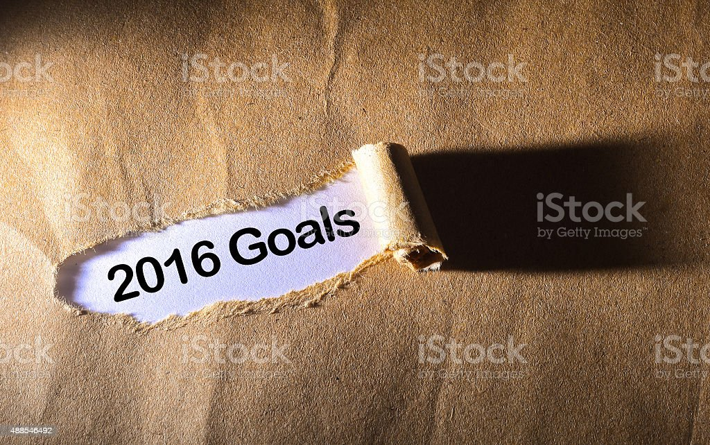 Torn paper with 2016 goals word stock photo
