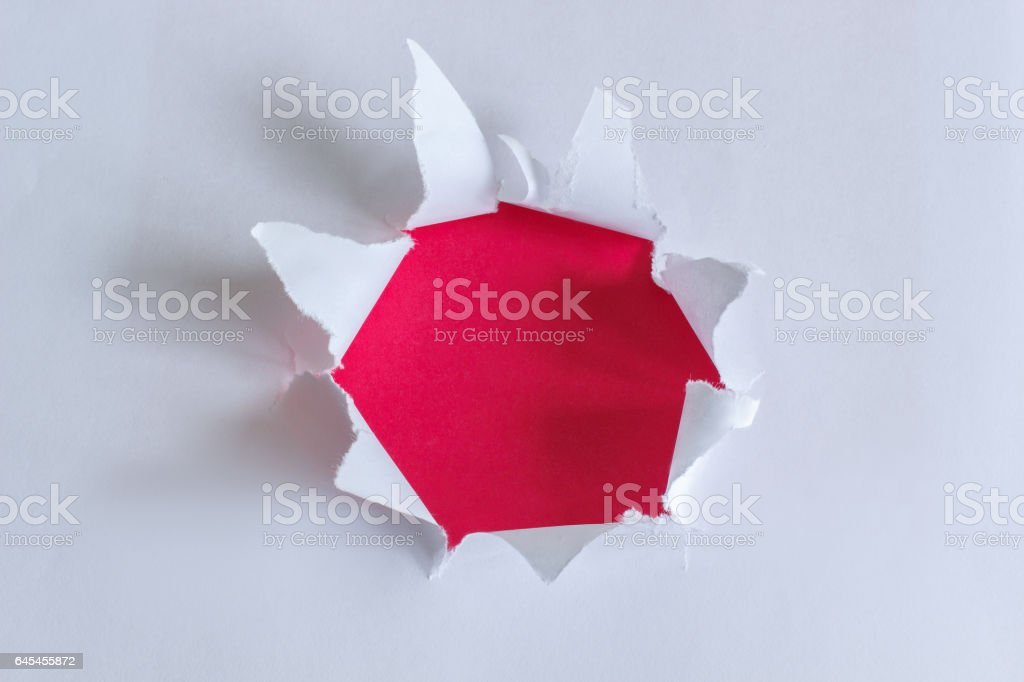 Torn paper with red background. stock photo