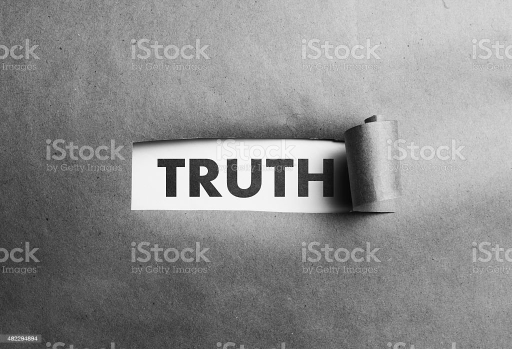 Torn paper with truth word behind it stock photo