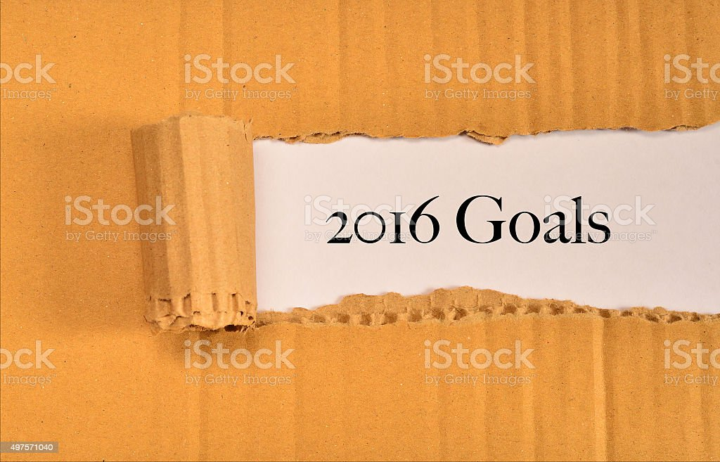 torn paper with word 2016 goals stock photo