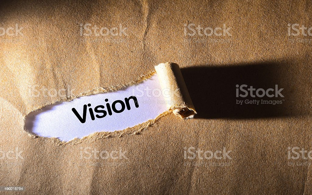 torn paper with word vision stock photo