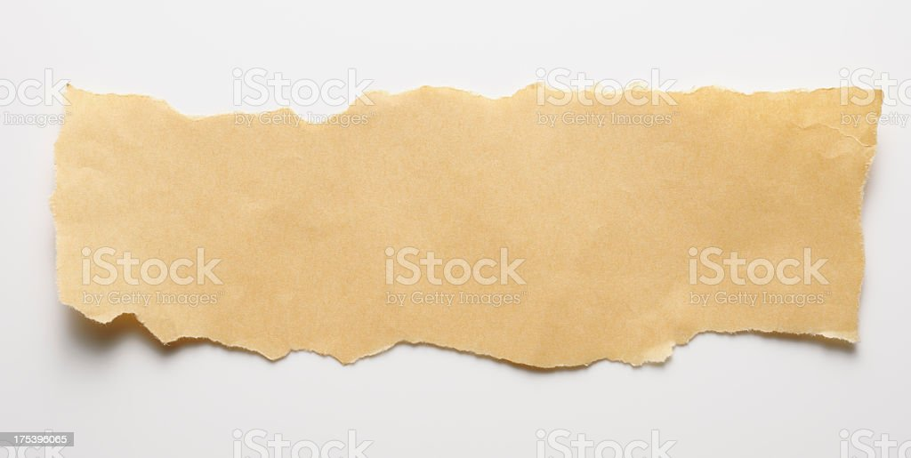 Torn piece of brown paper on white background royalty-free stock photo