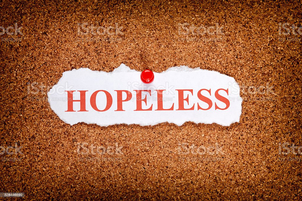 Torn piece of paper with word Hopeless stock photo