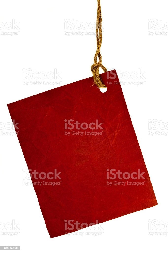 Torn piece of red paper. stock photo