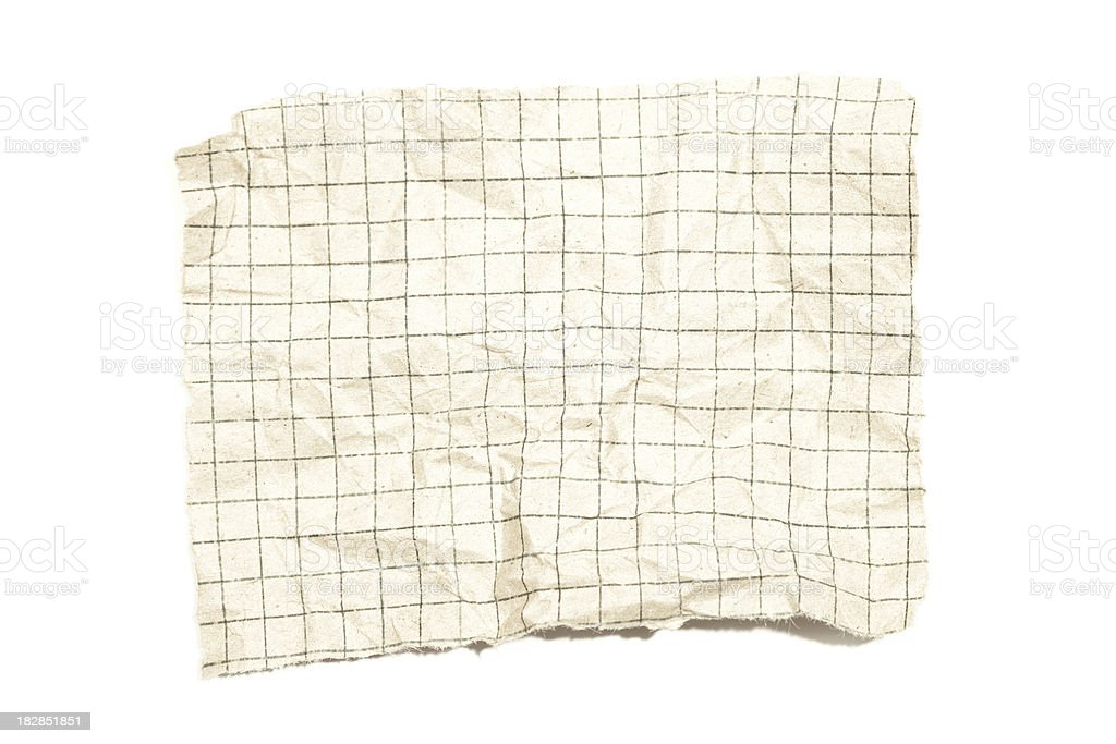 Torn piece of squared old paper. royalty-free stock photo