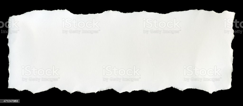 A torn piece of white paper on a black background stock photo
