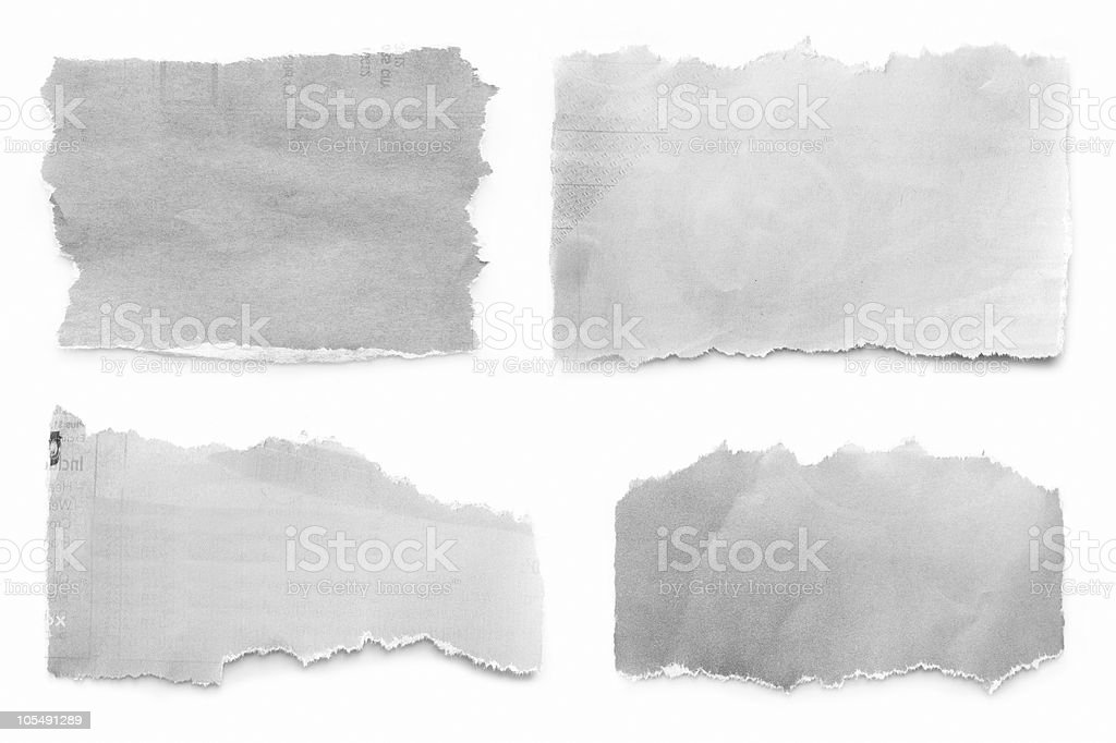 Torn pieces of newspaper on white background stock photo