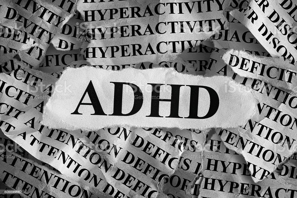 Torn pieces of paper with abbreviation ADHD stock photo