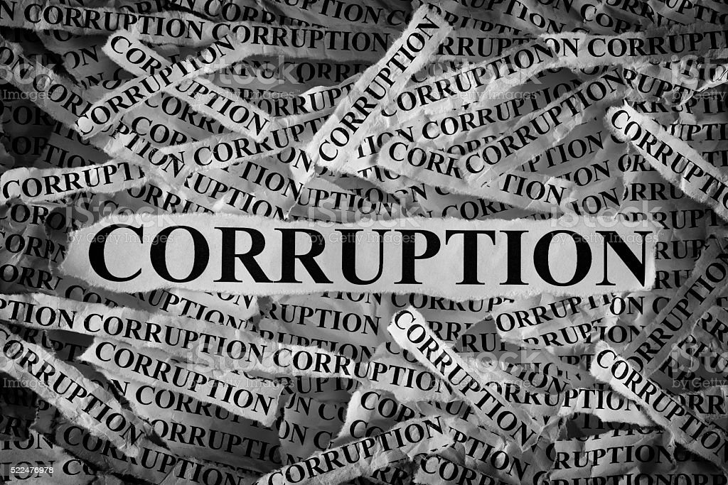 Torn pieces of paper with the word Corruption stock photo