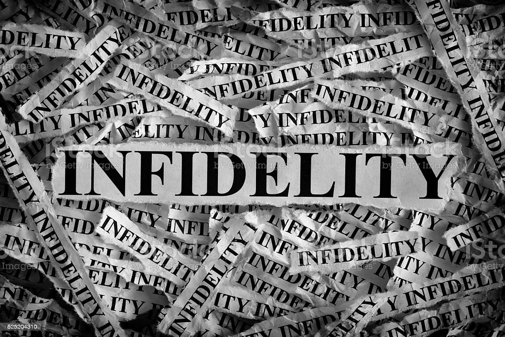 Torn pieces of paper with the word Infidelity stock photo