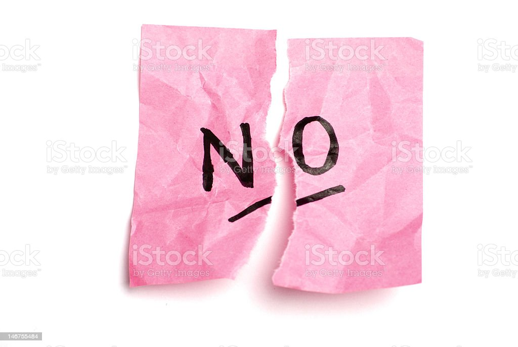 Torn pink postit with