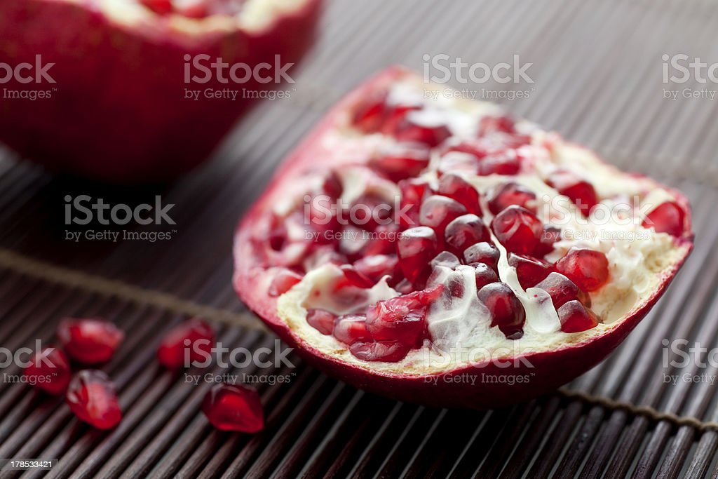 Torn pomegranate and seeds. royalty-free stock photo
