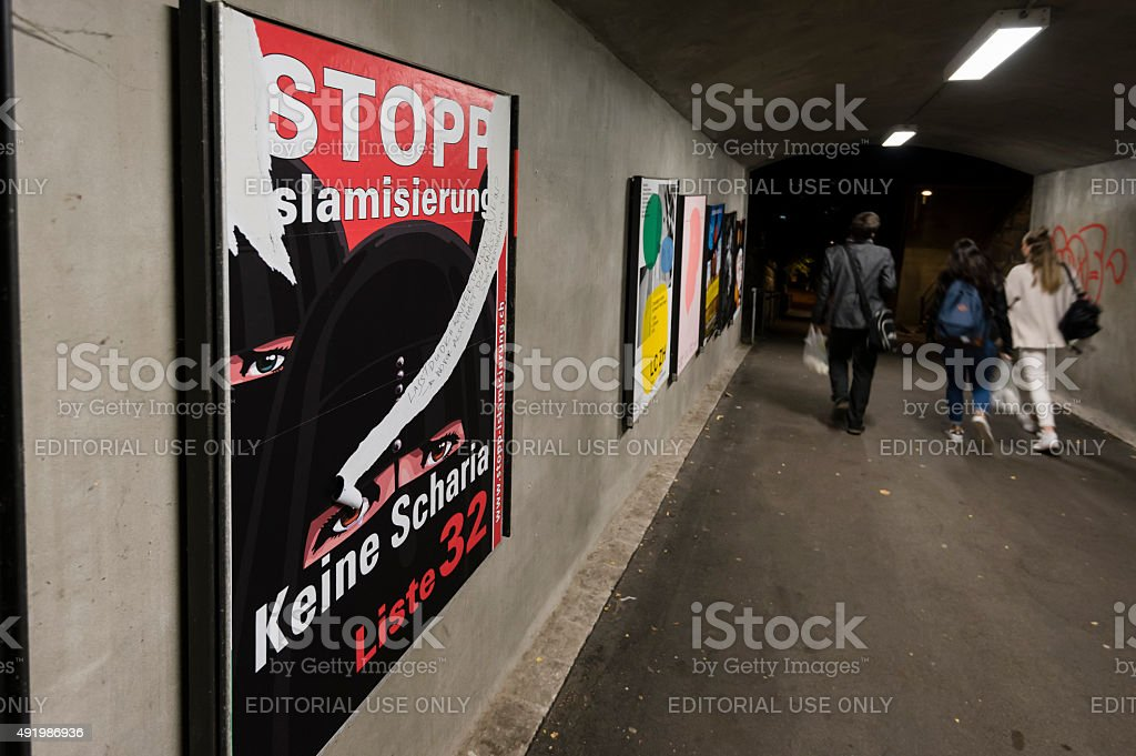 Torn right-wing nationalist campaign poster in Zurich stock photo