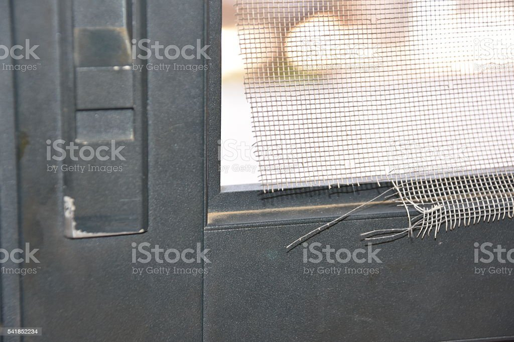 Torn screen door stock photo