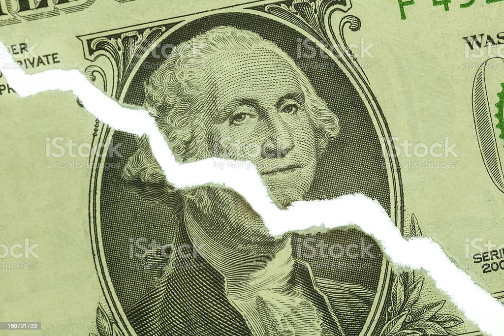 Torn US Dollar Showing Downward Trend Chart stock photo