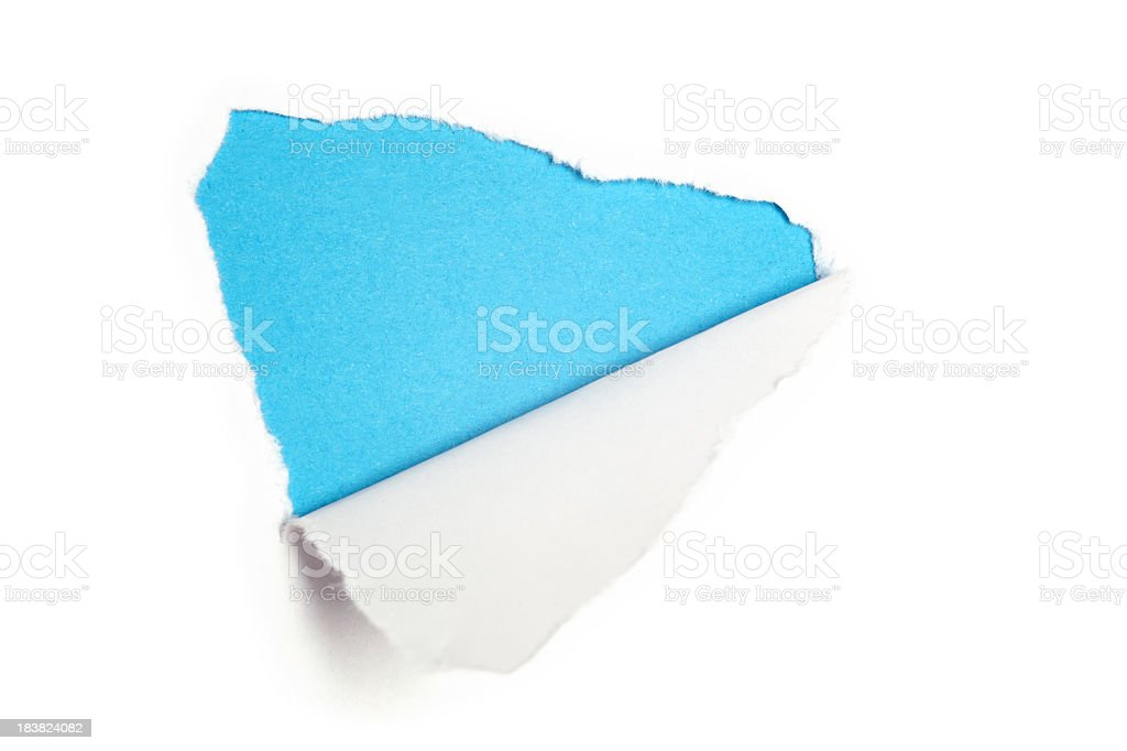Torn white paper revealing light blue background stock photo