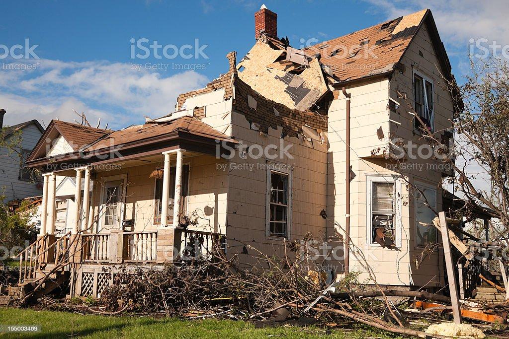Tornado battered home severely damaged. stock photo