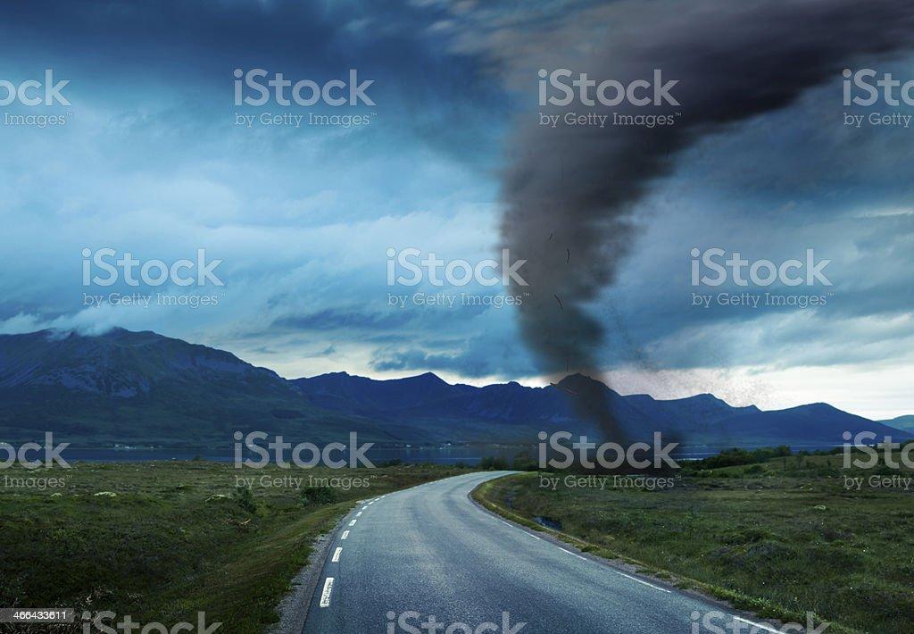 tornado on road stock photo