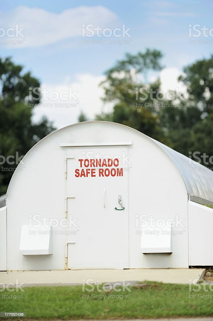 Tornado weather shelter with clear sky royalty-free stock photo