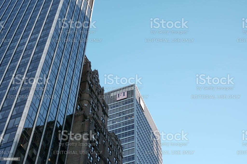 Toronto, Canada - October 10 2016: Tall architecture, showing a corporate headquarters of a famous, broadsheet financial newspaper showing the companies logo near the top of the newly built office block and HQ stock photo