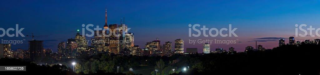 Toronto city lights panorama downtown skyscrapers CN Tower illuminated royalty-free stock photo