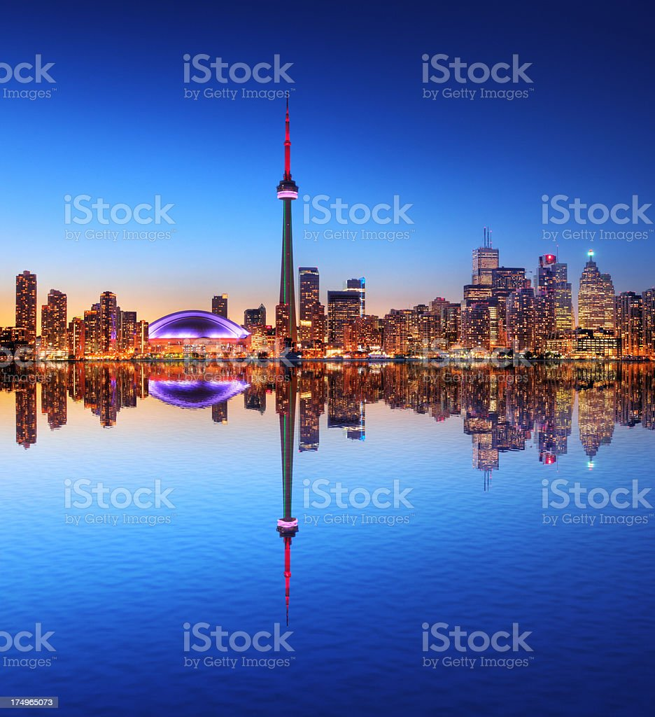 Toronto City Skyline with Water Reflection at Sunset stock photo