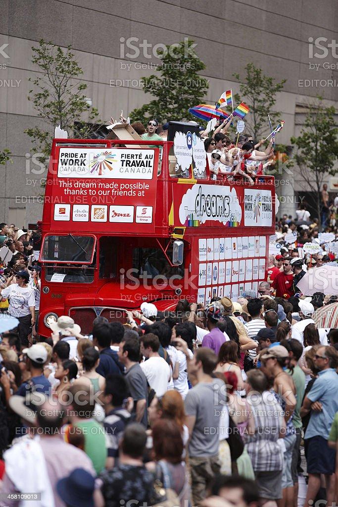 Toronto Gay Pride Parade participants on red double-decker bus stock photo