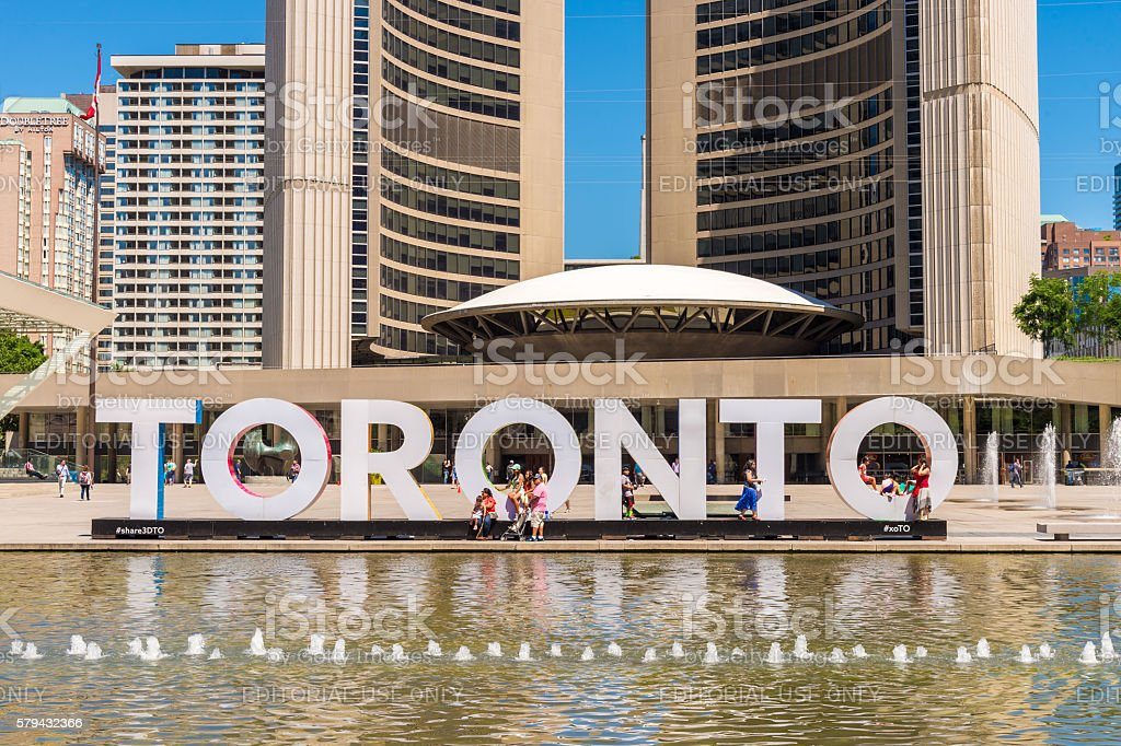 3D Toronto sign and Nathan Phillips Square in Toronto, Canada stock photo