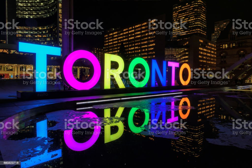 Toronto Sign on Nathan Phillips Square at night, in Toronto, Canada. stock photo