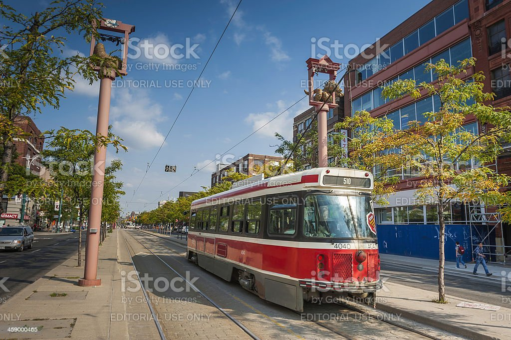 Toronto tram rolling through Chinatown in summer Canada royalty-free stock photo
