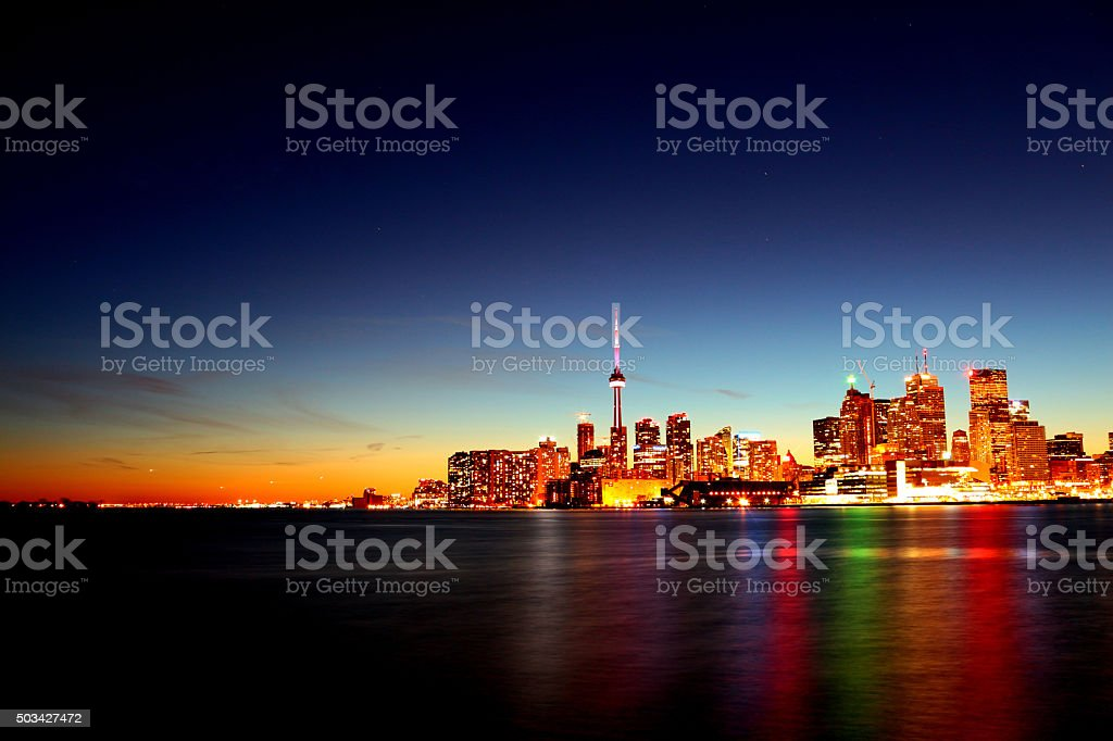 Toronto with rainbow in lake stock photo