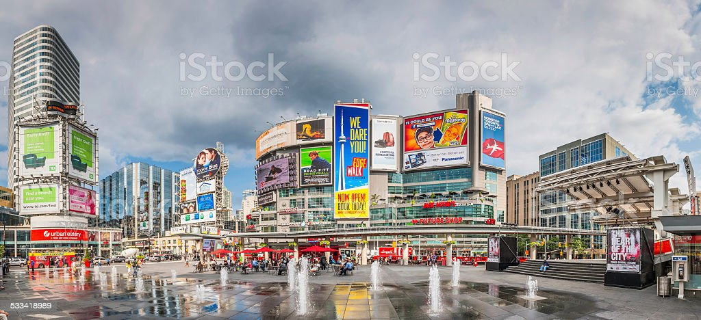 Toronto Yonge Dundas Square crowds fountains colourful billboards panorama Canada stock photo