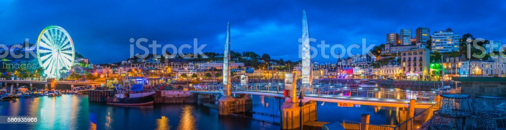 Torquay harbour waterfront hotels illuminated at dusk panorama Devon UK stock photo