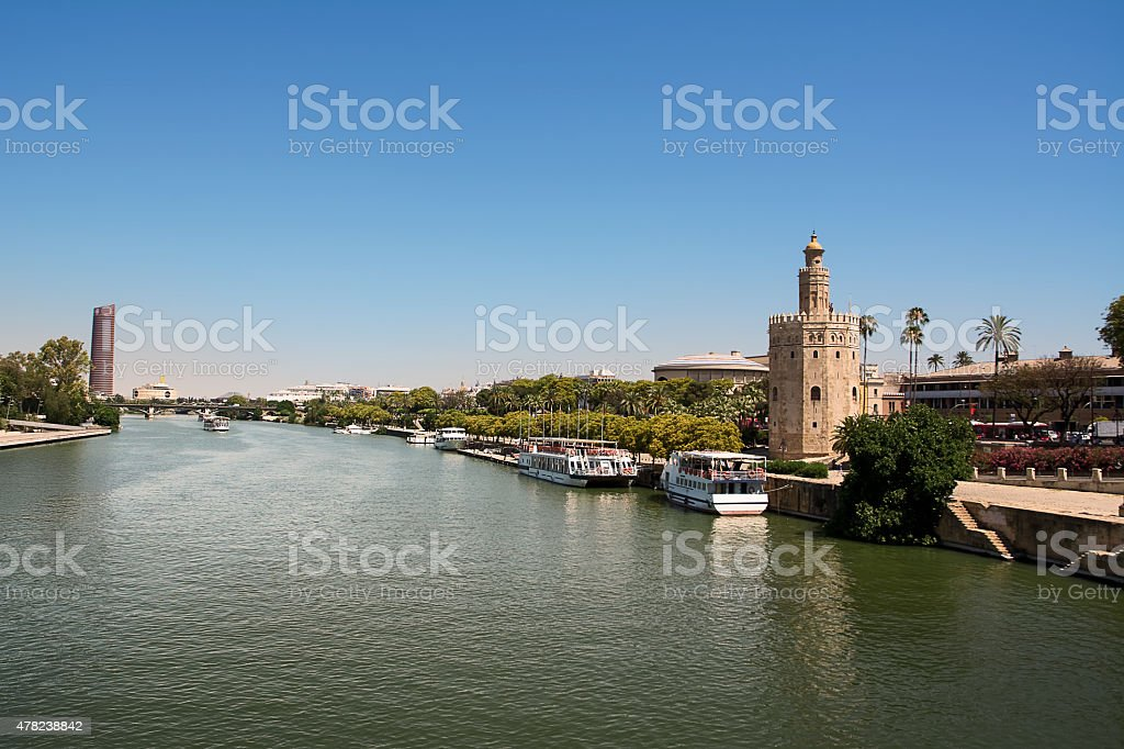 Torre de Oro and pavilion of navigation stock photo