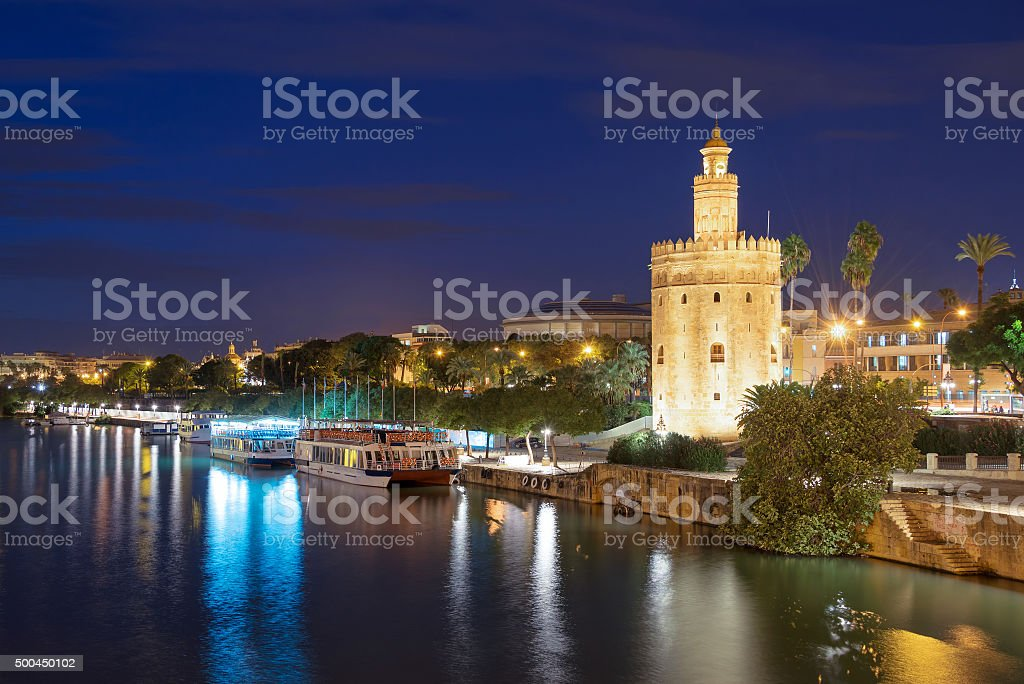Torre de Oro (Tower of Gold) at night in Seville stock photo
