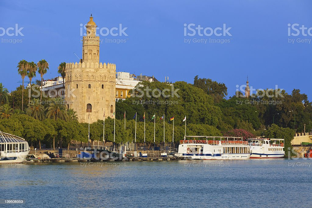 Torre del Oro over Guadalquivir river at sunset stock photo
